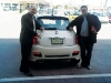 Marco Pasquariello (left) poses with Paolo Campli, sales manager at Maranello Fiat, after purchasing one of his three new Fiat 500s.