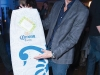 A guest walks away with a Corona wakeboard  just one of the lucky winners of the night