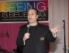 Emcee Michael Landsberg entertains guests at the 80s-themed dinner dance.