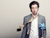 Simon Helberg dawns a grey blazer from Alkemy, white oxford shirt by Banana Republic, dark wash denim jeans from Blessed and Cursed, and a belt by Billionaire Mafia. Hair & Makeup Styling by Alison Christian, Fashion Styling by Devon Poer, Photography by Lily Stein