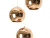You can hang this spherical copper light alone or in groups to form shiny chandeliers. Either way, this gleaming Tom Dixon fixture reflects its stunning surroundings.