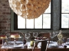 Impossible to miss, this massive chandelier is made from a meadow of paper flowers and glows with soft warmth – the perfect addition for the more whimsical homeowner searching for that pastoral ornament.