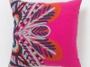 Throw a bright pillow on any solid-coloured chair or couch. Adding accents of hot pink can change the look of your space, making it both feminine and fun. www.anthropologie.com