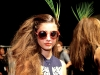 A Mara Hoffman model sports a pair of '70s-inspired shades, showing off the line's classic, cool vibe.
