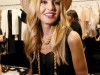 Rachel Zoe shows off one of the key elements of her latest line: the ever-trendy panama hat.