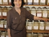 Evelyn Dorfman of Thuna Herbals stands behind her expansive herb collection. Among her favourites are yarrow flower and Siberian ginseng. (Photo by William Lem)