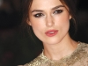 Actress Keira Knightly makes a makeup statement with bold eyebrows and vibrant lips