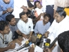 Amma speaks with journalists.