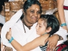Having hugged over 31 million people from around the world, Amma brings joy to one more child with her motherly embrace.