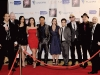 Actors who have worked with Reel Film Pictures gather for a group shot on the red carpet.