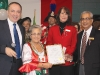 Vaughan Mayor Maurizio Bevilacqua presents an award to the Community & Home Assitance to Seniors charity.