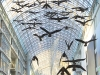 Flight Stop, 1979. Sixty suspended fibre-glass Canada geese forms surfaced with tinted black and white photographs. 3200 x 2000 x 1600 cm. Collection of the Eaton Centre, Toronto
