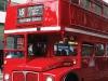 A London Bus roars down the street past Trafalgar Square.