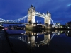 The Tower Bridge gleams  with the romance of a fairy tale.
