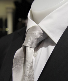 Neutral colours sparkle when paired with a silver tie.