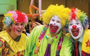 Three happy clowns